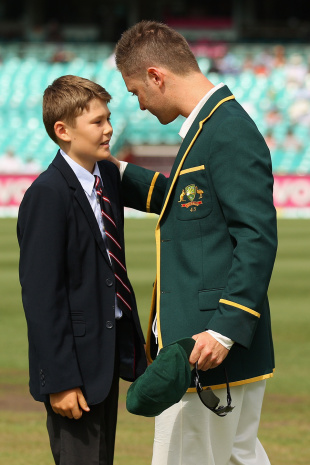 Tony Greig's ten-year-old son Tom talks to Michael Clarke, Australia v Sri Lanka, 3rd Test, Sydney, 1st day, January 3, 2013