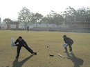 J Arunkumar, Karnataka's coach, gives close-in catching practice