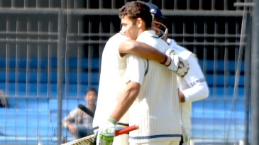 Rajat Paliwal being congratulated after completing his hundred