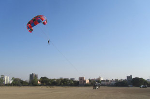 Parasailing goes on in an adjacent field, Saurashtra v Karnataka, quarter-final, Ranji Trophy 2012-13, Rajkot, January 9, 2013