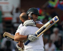 Hashim Amla embraces Faf du Plessis after reaching his century