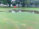 The wet outfield at Triangle Country Club