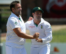 Dean Elgar congratulates Jacques Kallis as South Africa claimed the first wicket of the day