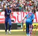 Steven Finn celebrates after dismissing Ajinkya Rahane