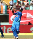 Suresh Raina heaves a ball towards midwicket