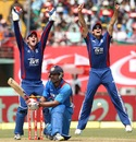 England fielders appeal for leg before as Yuvraj Singh misses a sweep shot, India v England, 2nd ODI, Kochi, January 15, 2013