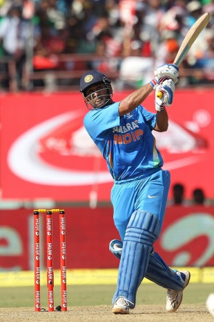MS Dhoni sends one to the stands during his knock of 72, India v England, 2nd ODI, Kochi, January 15, 2013
