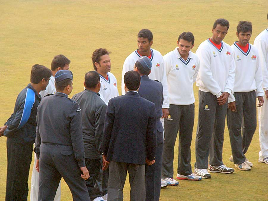 Sachin Tendulkar shakes hands with Air Vice-Marshal DC Kumaria ahead of the Ranji Trophy semi-final