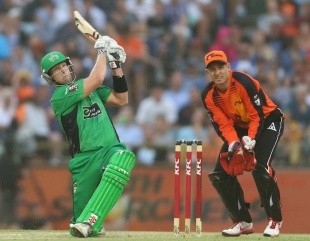 Cameron White slogs over the leg side as Michael Hussey keeps wicket, Perth Scorchers v Melbourne Stars, BBL semi-final, Perth, January 16, 2013