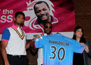 Brian Lara poses with a Mahmudullah Chittagong Kings shirt