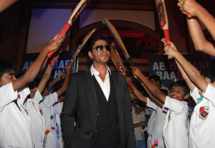 Bollywood actor Shahrukh Khan gets a guard of honour at the launch of the 'Toyota University Cricket Championship', Mumbai, January 17, 2013