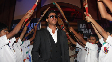 Bollywood actor Shahrukh Khan gets a guard of honour at the launch of the 'Toyota University Cricket Championship'