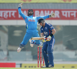 MS Dhoni leaps after getting Ian Bell out caught, India v England, 3rd ODI, Ranchi, January 19, 2013
