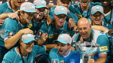 Brisbane Heat celebrate with the BBL trophy