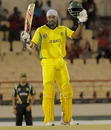 Chris Gayle acknowledges the applause after reaching his century, Jamaica v Guyana, Caribbean T20, playoff, St Lucia, January 19, 2013