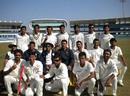 Saurashtra players pose for a group photograph after qualifying for Ranji Trophy final