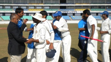 SCA secretary Niranjan Shah congratulates the Saurashtra players