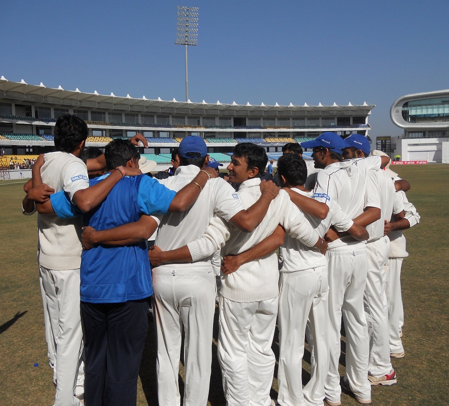 Saurashtra players get into a huddle after winning the semi-final