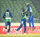 Elton Chigumbura is congratulated on taking a wicket, Duronto Rajshahi v Sylhet Royals, Bangladesh Premier League, January 20, 2013