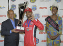T&T captain Denesh Ramdin receives the Caribbean T20 trophy