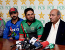 Afghanistan captain Nawroz Mangal (right) at a press conference with coach Kabir Khan (centre) and Intikhab Alam, Lahore, January 21, 2013