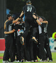 Victory huddle: New Zealand gather in joy after their 27-run win