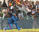 Bhuvneshwar Kumar prepares to hold a catch and is cheered by fans