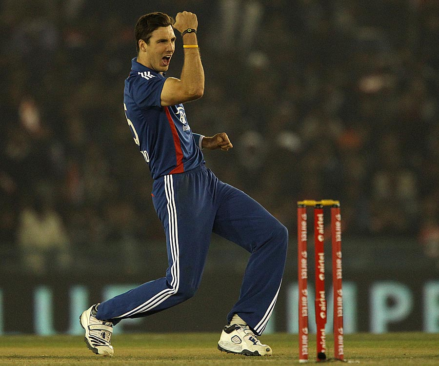 Steven Finn celebrates after getting Rohit Sharma out