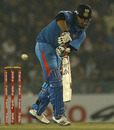 Suresh Raina plays one through the leg side, India v England, 4th ODI, Mohali, January 23, 2013