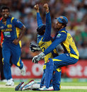 Dinesh Chandimal hugs Tillakaratne Dilshan after a smart bit of fielding