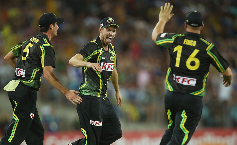 Ben Laughlin celebrates his catch with Ben Cutting and Aaron Finch