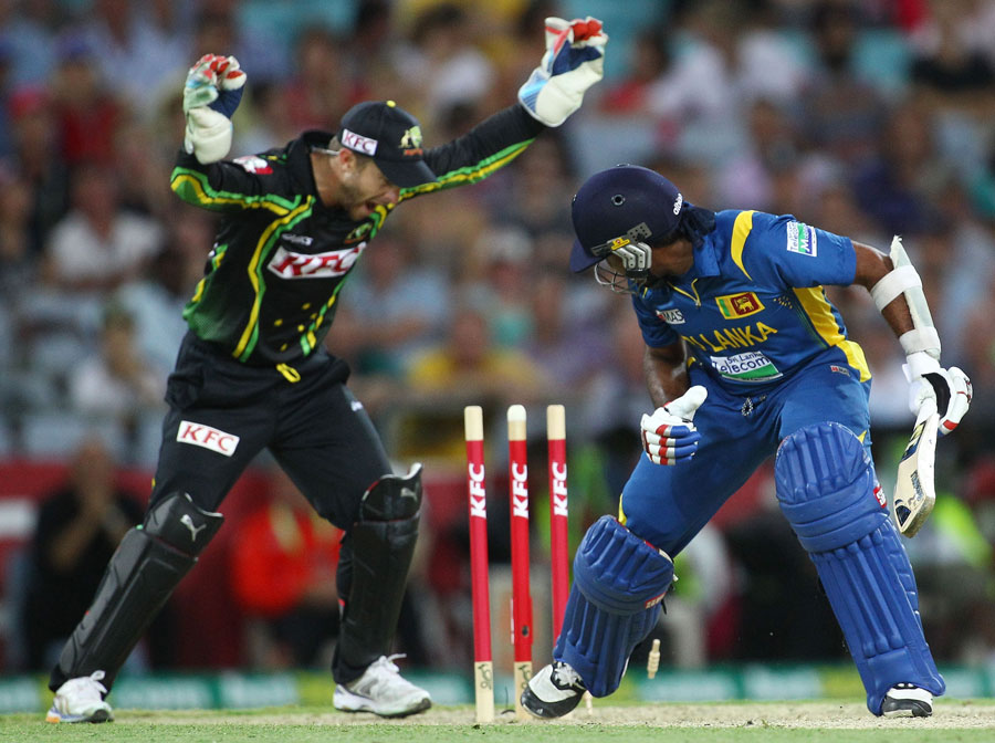 Mahela Jayawardene looks round to see his stumps disturbed