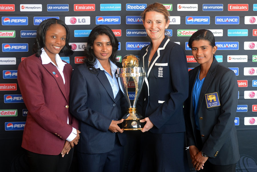 West Indies, India, England and Sri Lanka captains pose with the trophy