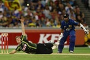 James Faulkner attempts to stop the ball off his own bowling