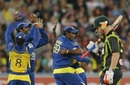 Sri Lanka celebrate the wicket of David Warner