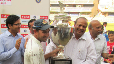 Mumbai captain Ajit Agarkar receives the Ranji Trophy