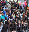 Brian Lara gets mobbed during a visit to a local school, Chittagong, January 29, 2011