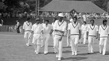 Clive Lloyd leads his team out