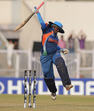 Kamini celebrates her century. Courtesy: Cricinfo.com