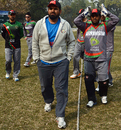 Afghanistan's coach Kabir Khan with players at a coaching camp, Lahore, January 31, 2013