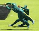 Aaron Finch dives across from second slip to take a catch
