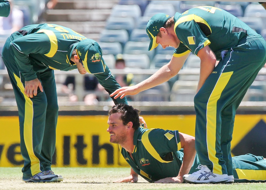 Clint McKay gets a pat on his back after getting Darren Sammy's wicket