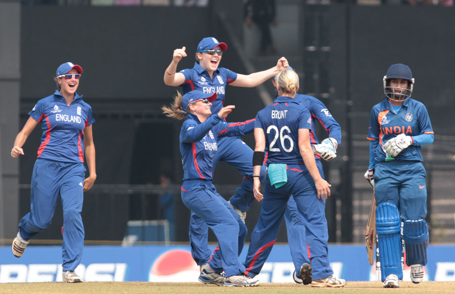 Katherine Brunt celebrates taking the wicket of Mithali Raj