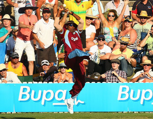 Kieron Pollard takes another brilliant catch at the boundary to dismiss George Bailey, Australia v West Indies, 3rd ODI, Canberra, February 6, 2013