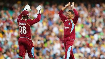 Devon Thomas and Sunil Narine exchange high-fives