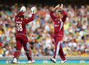 Devon Thomas and Sunil Narine exchange high-fives