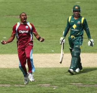 Dwayne Bravo is delighted after removing Phil Hughes, Australia v West Indies, 5th ODI, Melbourne, February 10, 2013
