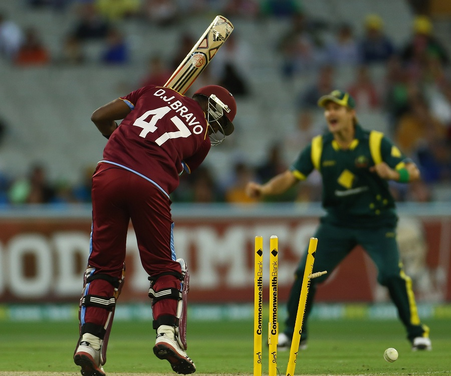 Dwayne Bravo is bowled by Mitchell Johnson
