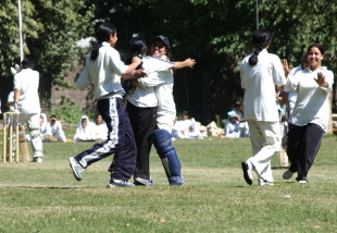College students celebrate a wicket during a match at the Women's College, Srinagar, September 13, 2005