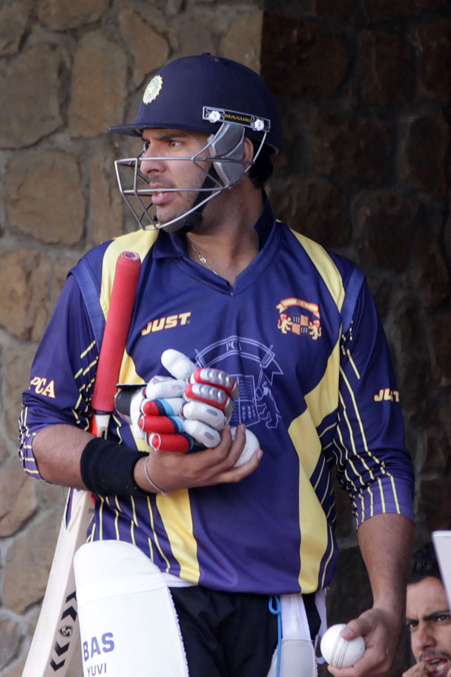 Yuvraj Singh pads up to bat during the Punjab-Haryana match